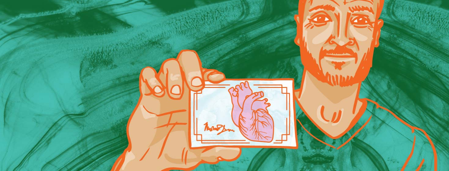 man holding a membership card with an anatomical heart on it