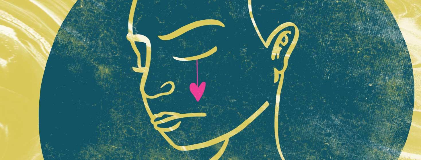 a heart shaped tear rolls down the cheek of a woman