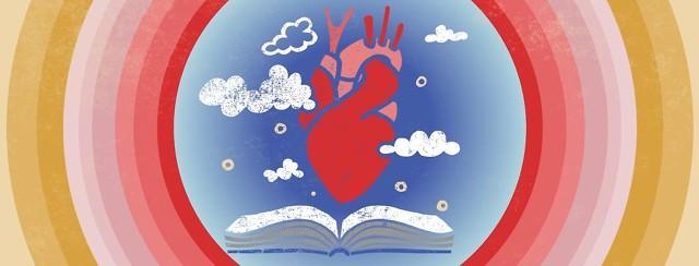 an anatomical heart floats above an open book
