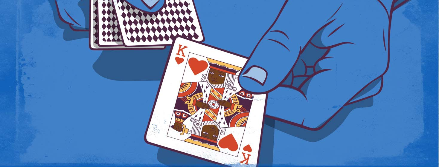 hands holding cards deal out the king of hearts