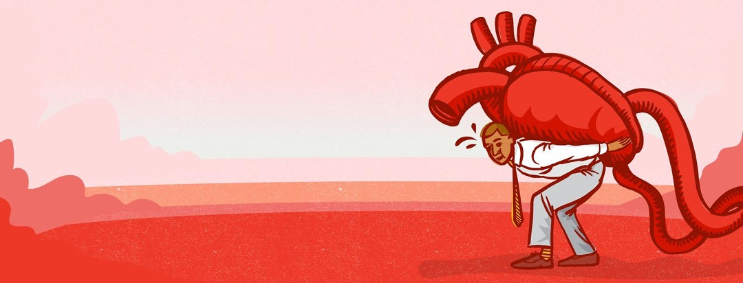 a man struggles to carry a giant anatomical heart on his back