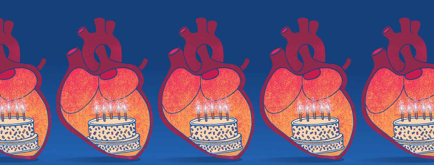five anatomical hearts with birthday cakes inside of them
