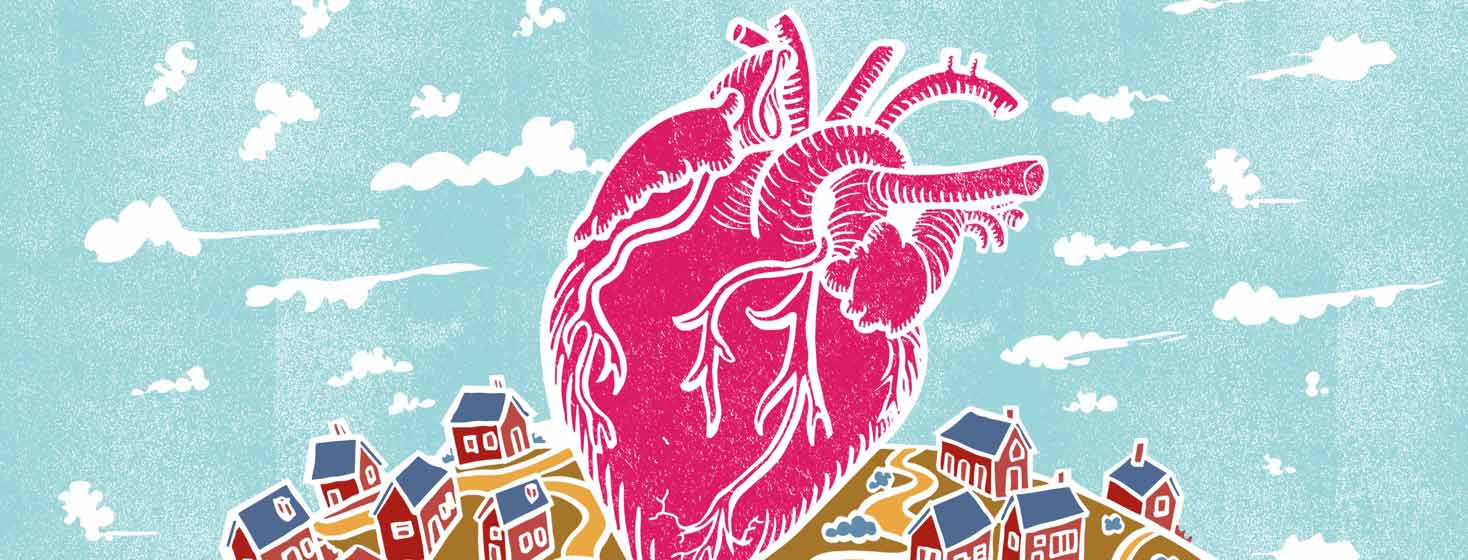 a large anatomical heart sits in the center of a small village