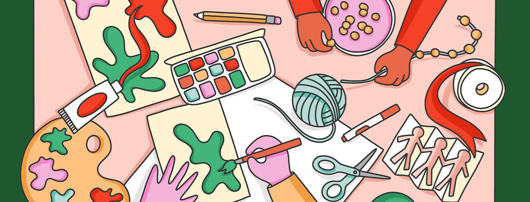 A chaotic table of arts and crafts with hands entering the frame to paint and string beads. Crafting, arts, staying inside, activity, family fun