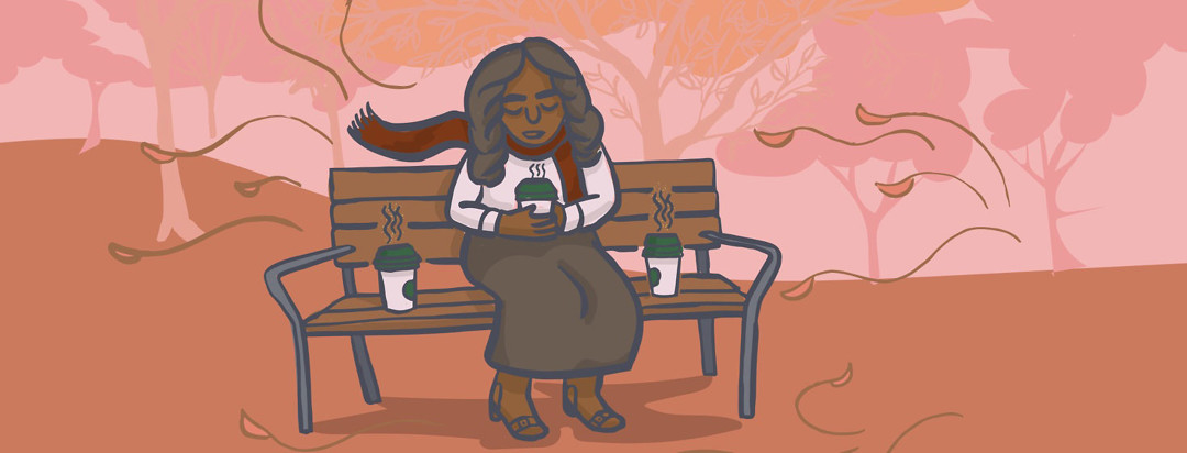 a woman sits on a park bench holding a cup of coffee with two cups of coffee on either side of her while leaves fall behind her.