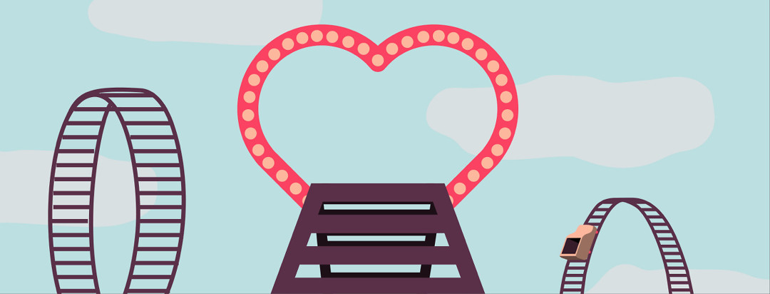 a rollercoaster with a heart gate at the top right before the plunge