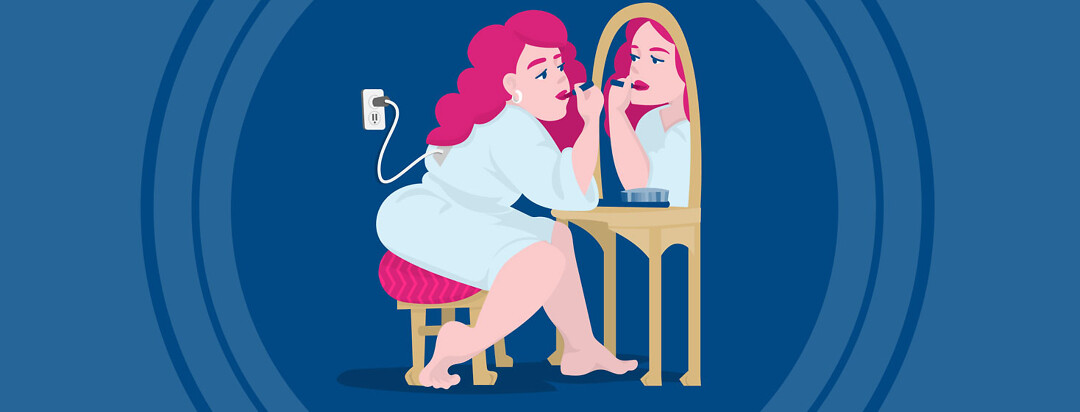 a woman has a plug going from her back to an electrical socket in the wall as she sits at a table and puts on her lipstick