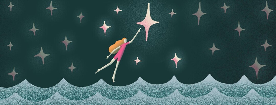 Woman floating over water reaching for a star in the night sky.
