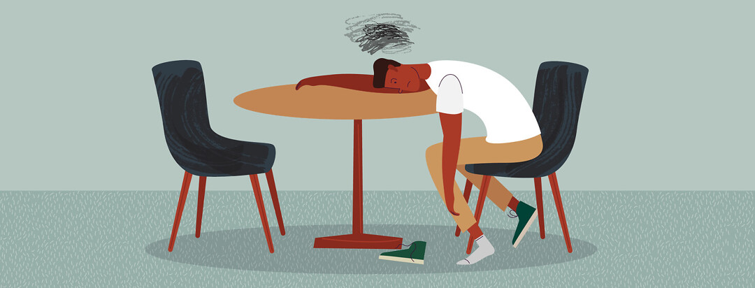 Man bent over laying on table with one shoe on and fuzzy lines over head, apathy. Adult male POC kitchen table, exhausted.
